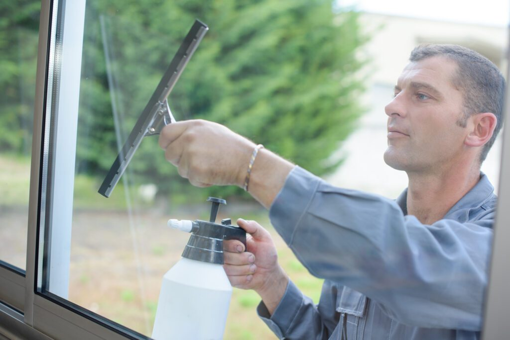 man cleaning windows with different powder coating types